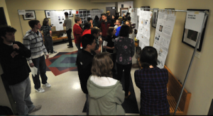 "Students in the University of Wisconsin class ""Life in the Universe"" display their research project posters."